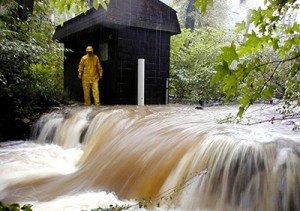 Photo of one of SERC's weirs overflowing during Hurricane Floyd in 1999.