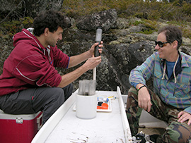 Scientists extract sediment core to test for mercury.